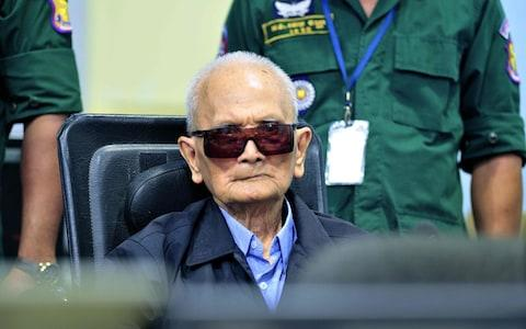 Former Khmer Rouge leader Nuon Chea sits in court at the ECCC in Phnom Penh - Credit: MARK PETERS/ AFP