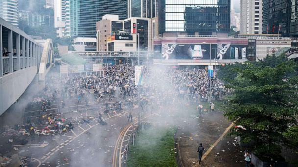 PHOTO: Tear gas is seen outside the Legislative Council during violent clashes between police and protesters rallying against a controversial extradition law proposal outside the government headquarters in Hong Kong, June 12, 2019. (Philip Fong/AFP/Getty Images)