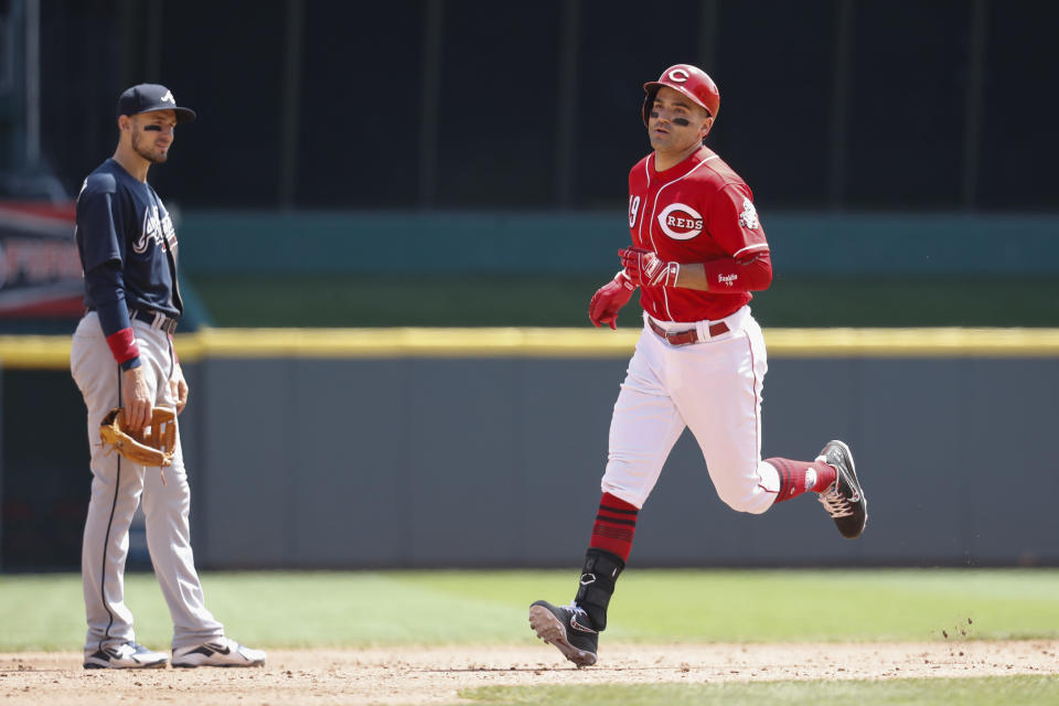 Cincinnati Reds star Joey Votto isn't afraid of a little cold weather if it means he can play more baseball. (AP Photo)