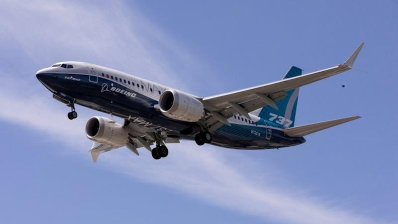 A Boeing 737 MAX airplane lands after a test flight at Boeing Field in Seattle.