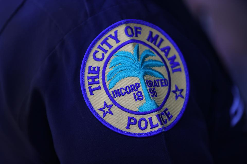 MIAMI, FLORIDA - MARCH 15: A patch is seen on the shoulder of a police officer as the City of Miami's new Police Chief Art Acevedo speaks to the media during his introduction at City Hall on March 15, 2021 in Miami, Florida. Acevedo is leaving his job as police chief in Houston, Texas to take over Miami's police department of about 1,400 officers. (Photo by Joe Raedle/Getty Images)
