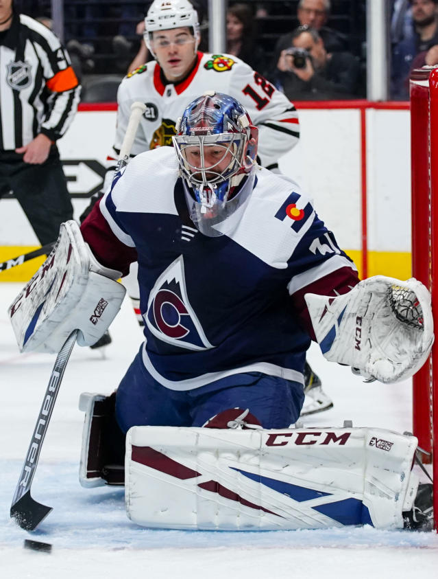 Colorado Avalanche goaltender Philipp Grubauer (31) blocks a shot against the Chicago Blackhawks during the first period of an NHL hockey game, Saturday, March 23, 2019 in Denver. (AP Photo/Jack Dempsey)