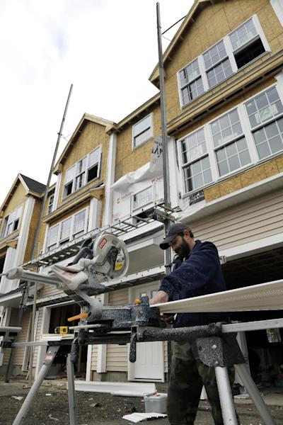 In this Dec. 20, 2012 photo, a builder works in North Andover, Mass., where condominium units are under construction. Spending on U.S. construction projects rose in December, ending a year in which construction activity increased for the first time in six years. (AP Photo/Elise Amendola)