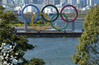 The Olympic rings is seen at Tokyo's Odaiba district Tuesday, March 24, 2020. The CEO of the Tokyo Olympics and the IOC member in charge of Japan's games have both dismissed a new study from the University of Oxford that finds Tokyo is the most expensive Summer Games dating back to 1960. (AP Photo/Eugene Hoshiko, File)