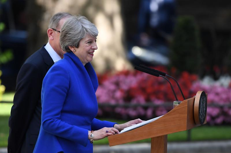 Former British Prime Minister Theresa May makes her outgoing statement alongside husband Philip May at Downing Street. [Photo: Getty]