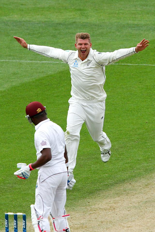 WELLINGTON, NEW ZEALAND - DECEMBER 12:  Corey Anderson of New Zealand celebrates after taking the wicket of Darren Bravo of the West Indies during day two of the Second Test match between New Zealand and the West Indies at Basin Reserve on December 12, 2013 in Wellington, New Zealand.  (Photo by Hagen Hopkins/Getty Images)