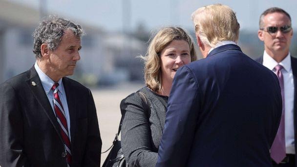 PHOTO: President Donald Trump is greeted by Dayton, Ohio, Mayor Nan Whaley as Sen. Sherrod Brown waits at left, as Trump arrived at Wright-Patterson Air Force Base before visiting the site of a mass shooting in Dayton, Ohio, Aug. 7, 2019. (Leah Millis/Reuters)
