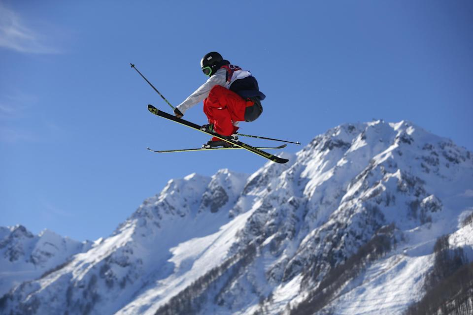 Joss Christensen of the United States competes in the men's ski slopestyle qualifying at the Rosa Khutor Extreme Park, at the 2014 Winter Olympics, Thursday, Feb. 13, 2014, in Krasnaya Polyana, Russia. (AP Photo/Sergei Grits)