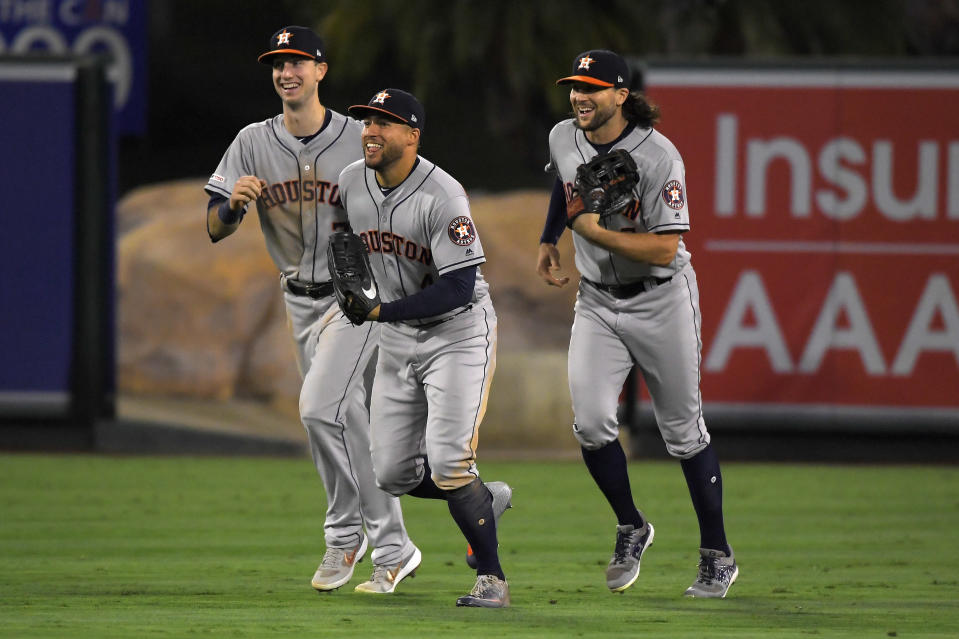 Houston Astros, from left, Kyle Tucker, George Springer and Jake Marisnick celebrate after the Astros defeated the Los Angeles Angels 4-0 in a baseball game, Friday, Sept. 27, 2019, in Anaheim, Calif