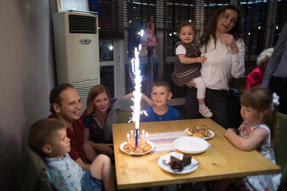 """Tsvetelina and Svilen Hristov celebrate the birthday of their son Toma last year at a restaurant in Sofia. The family moved to France for Svilen's job. <span class=""""copyright"""">(Jodi Hilton / For The Times)</span>"""