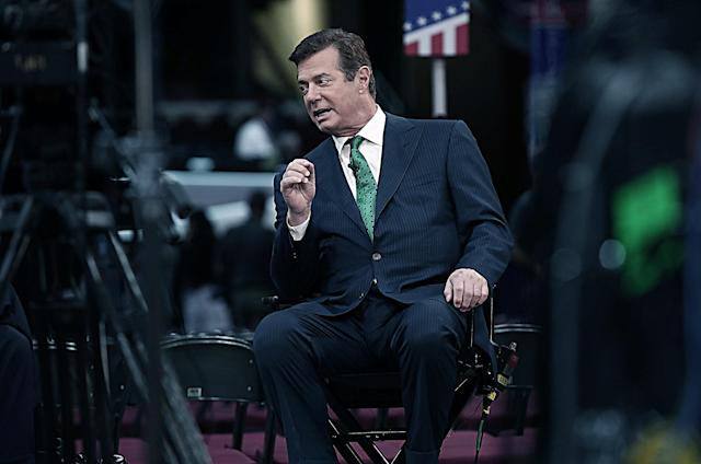 Paul Manafort, campaign manager for Republican presidential candidate Donald Trump, is interviewed on the floor of the Republican National Convention at the Quicken Loans Arena, July 17, 2016, in Cleveland. (Digitally enhanced photo: Win McNamee/Getty Images)