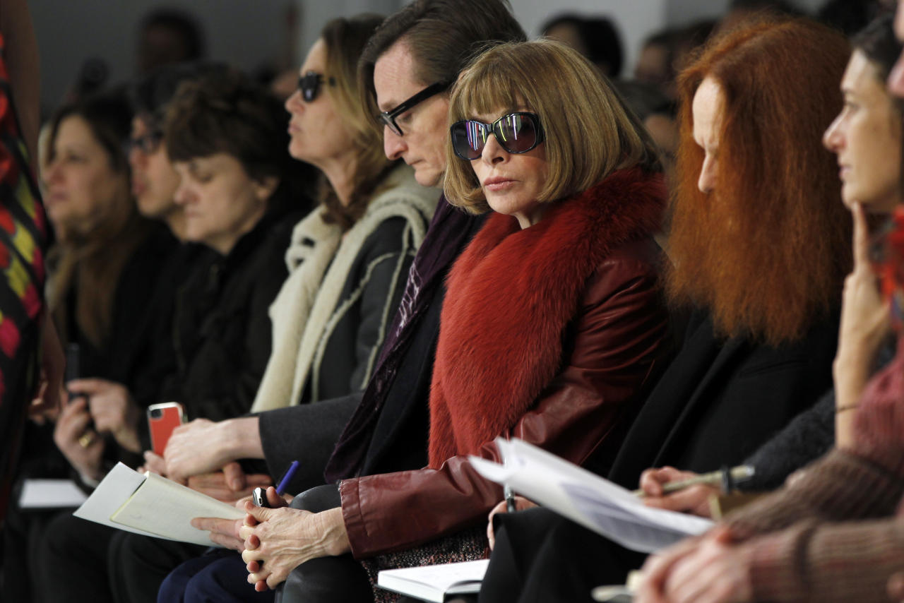 Vogue editor Anna Wintour watches a presentation of the Rodarte Autumn/Winter 2013 collection during New York Fashion Week, February 12, 2013. REUTERS/Lucas Jackson (UNITED STATES - Tags: FASHION) - RTR3DP8W