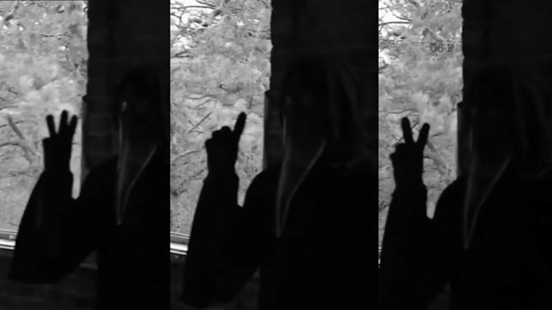 The spine-chilling video depicts a dark figure, covered in a dark and a death mask, gesturing multiple different visual codes. Photo: Supplied