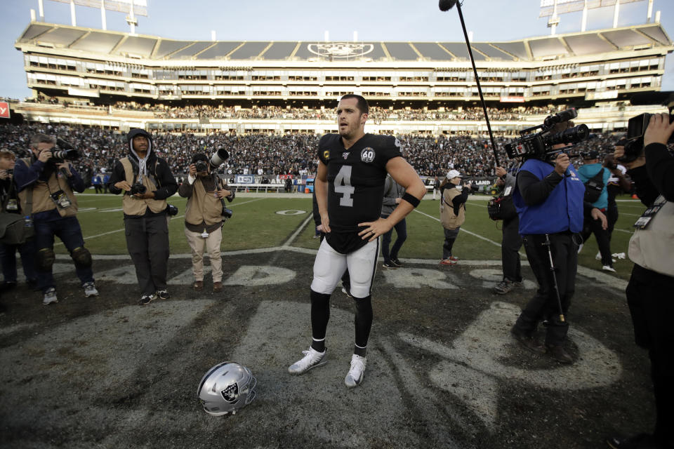 Oakland Raiders quarterback Derek Carr (4) stands on the field at the end of an NFL football game against the Jacksonville Jaguars in Oakland, Calif., Sunday, Dec. 15, 2019. (AP Photo/Ben Margot)