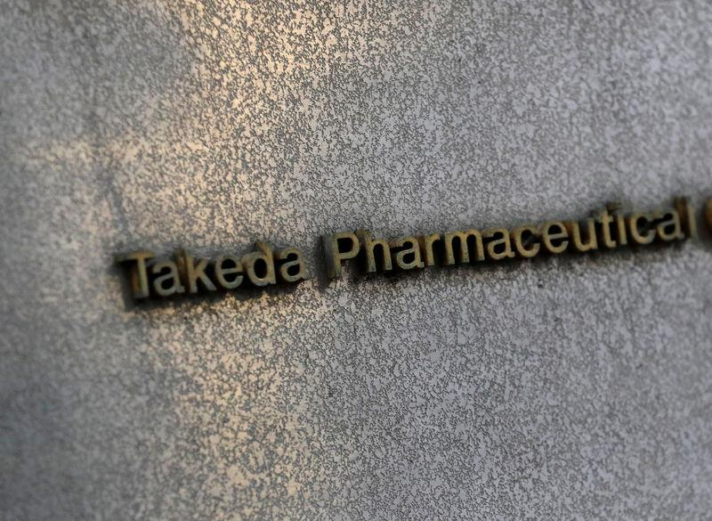 FILE PHOTO: Takeda Pharmaceutical's signboard is seen on its headquarters building in Tokyo