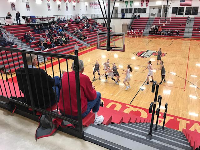 Jack Marlowe, left, and Jerry Farrell watch a Maquoketa High School girls' basketball game in Maquoketa, Iowa, on Jan. 30. (Photo: Holly Bailey/Yahoo News)
