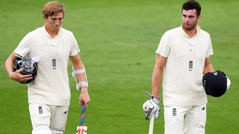 Zak Crawley and Dom Sibley, pictured here leaving the field after rain stopped play.