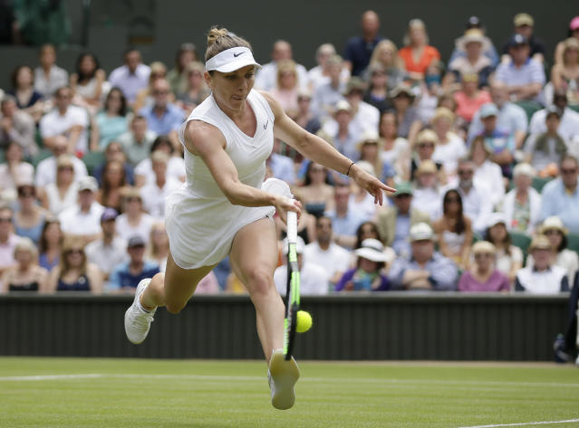 Romania's Simona Halep returns the ball to Ukraine's Elina Svitolina during a women's singles semifinal match on day ten of the Wimbledon Tennis Championships in London, Thursday, July 11, 2019. (AP Photo/Tim Ireland)