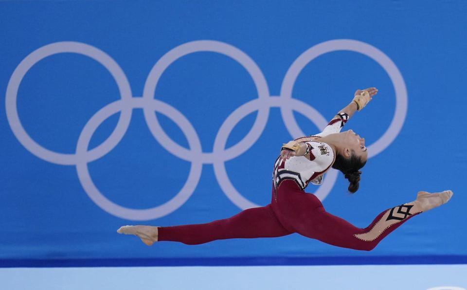 """<span class=""""caption"""">The German gymnastics team at the Tokyo Olympics wore full-legged unitards that went down to their ankles, eschewing the traditional bikini cut that ends high on the hip. The athletes said they were trying to combat the sexualization of young women and girls in their sport, which is trying to recover from a decades-long sexual abuse scandal.</span> <span class=""""attribution""""><span class=""""source"""">(AP Photo/Gregory Bull) </span></span>"""