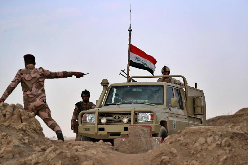 Iraqi security forces secure the Iraq-Syria border around the Rabiaa border crossing, Iraq, Wednesday, Oct. 16, 2019. Najah al-Shammari, Iraq's defense minister said that some members of the Islamic State group were able to flee northern Syria and cross into Iraq. The Iraqi official added that some of them are still at large while others were detained. (AP Photo/Hadi Mizban)