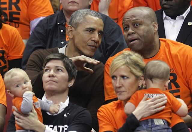 U.S. President Barack Obama attends the game between Princeton and Green Bay for the 2015 Women's NCAA Basketball Tournament at the XFINITY Center in College Park, Maryland March 21, 2015. Obama's niece Leslie Robinson plays for Princeton. REUTERS/Yuri Gripas