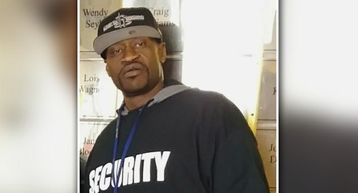 George Floyd wearing a hat and a shirt that says security.