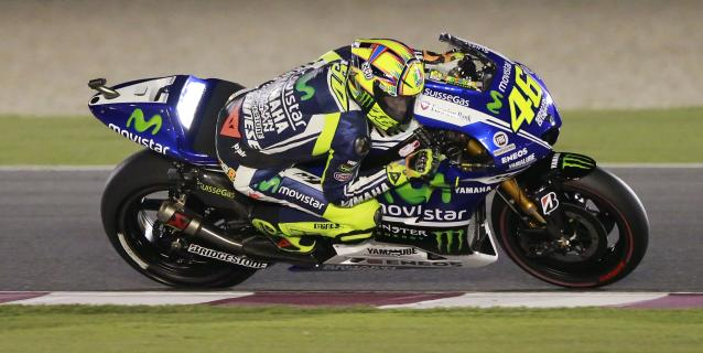 Yamaha MotoGP rider Valentino Rossi of Italy rides his bike during a free practice session at the MotoGP World Championship at the Losail International circuit in Doha March 22, 2014. REUTERS/Mohammed Dabbous (QATAR - Tags: SPORT MOTORSPORT)