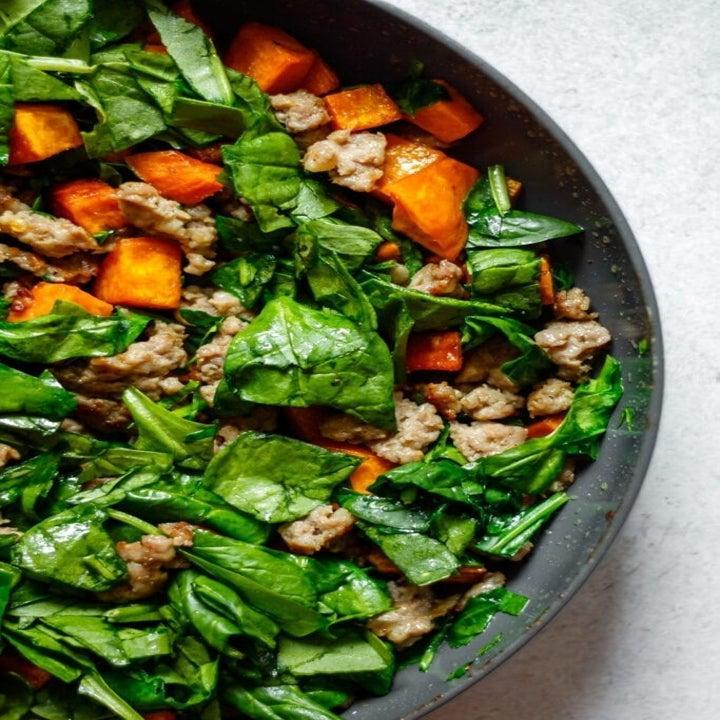 Spinach, sausage, and sweet potato in a skillet