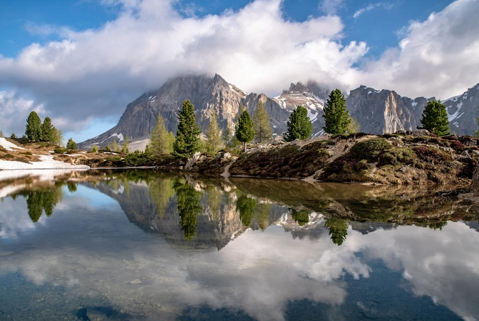 Mountains reflecting in Lago di Limides, South Tyrol on a spring morning (Photo: Achim Thomae via Getty Images)