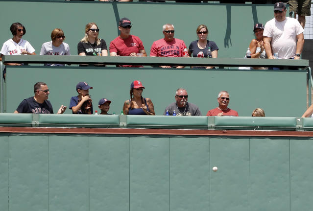 Fans in the Monster seats look on as a ball goes off the wall during the first inning of a baseball game between the Boston Red Sox and the Toronto Blue Jays Saturday, July 14, 2018, in Boston. (AP Photo/Winslow Townson)