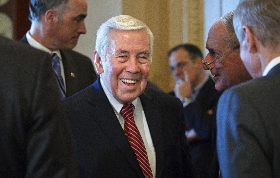 FILE - In this March 6, 2012, file photo Sen. Richard Lugar, R-Ind., the high profile 80-year-old ranking Republican on the Senate Foreign Relations Committee, waits with others for the arrival of the prime minister of Israel on Capitol Hill in Washington. The Senate's most senior Republican, serving in his sixth term, is the target of tea partyers trying to toss out veterans of the GOP establishment in the next election. (AP Photo/J. Scott Applewhite)
