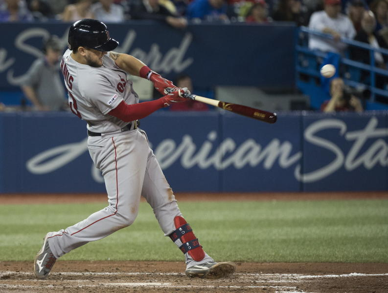 Boston Red Sox's Michael Chavis hits a single against the Toronto Blue Jays during the seventh inning of a baseball game in Toronto, Thursday, May 23, 2019. (Nathan Denette/The Canadian Press via AP)