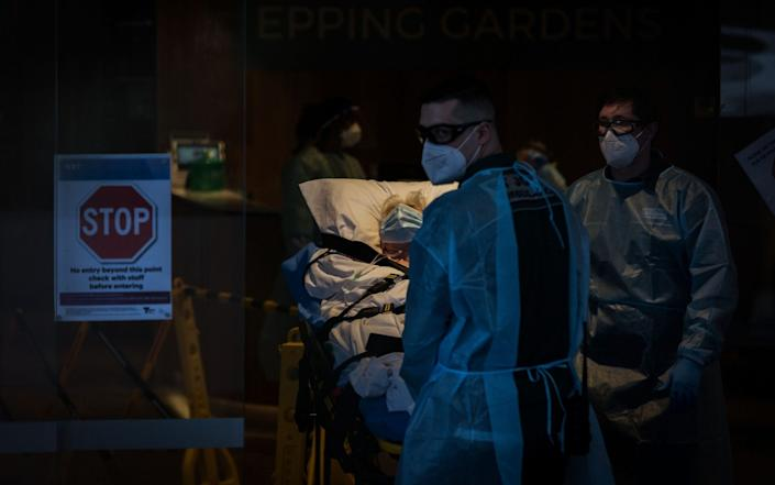 A resident of Epping Gardens Aged Care Facility is taken away in a ambulance in Melbourne - Getty