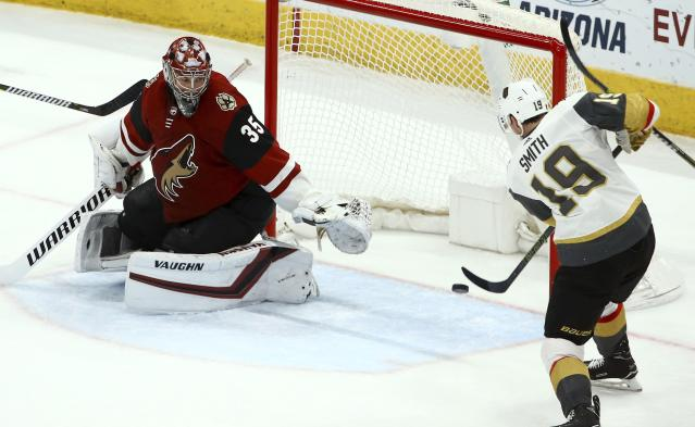 Vegas Golden Knights right wing Reilly Smith (19) scores a goal against Arizona Coyotes goaltender Darcy Kuemper (35) during the second period of an NHL hockey game Sunday, Dec. 30, 2018, in Glendale, Ariz. (AP Photo/Ross D. Franklin)