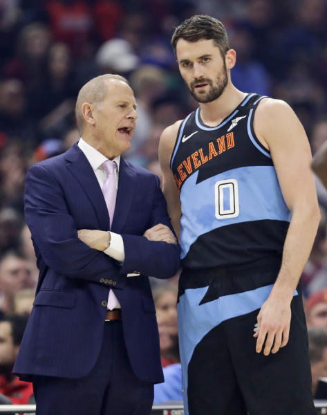 Cleveland Cavaliers coach John Beilein, left, talks with Kevin Love during the first half of the team's NBA basketball game against the New Orleans Pelicans, Tuesday, Jan. 28, 2020, in Cleveland. (AP Photo/Tony Dejak)
