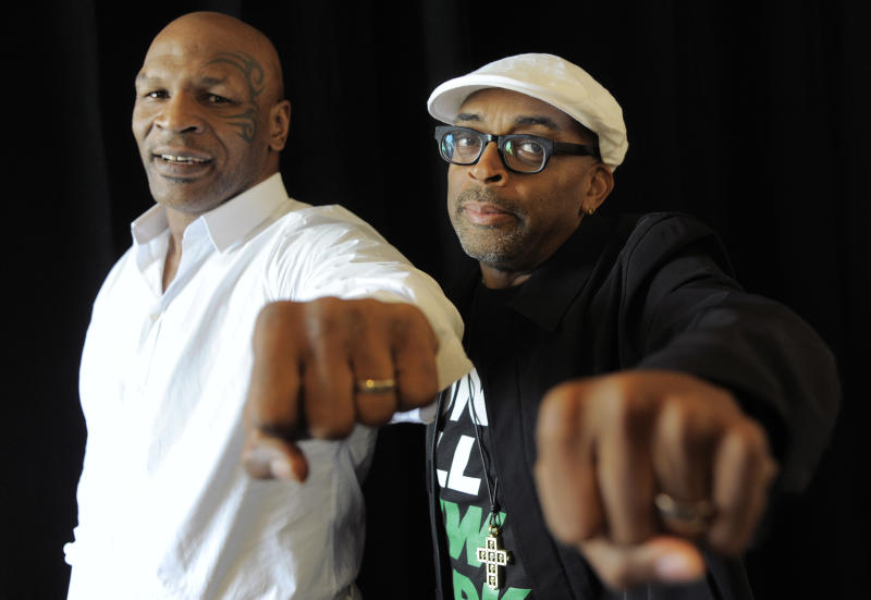 """Spike Lee, right, director of """"Mike Tyson: Undisputed Truth,"""" poses with Tyson backstage during HBO's Summer 2013 TCA panel at the Beverly Hilton Hotel on Thursday, July 25, 2013, in Beverly Hills, Calif. The former heavyweight champion teamed with Lee to bring Tyson's one-man stage show to HBO later this year. The program was filmed on Broadway, where ``Mike Tyson: Undisputed Truth'' ran last summer. (Photo by Chris Pizzello/Invision/AP)"""