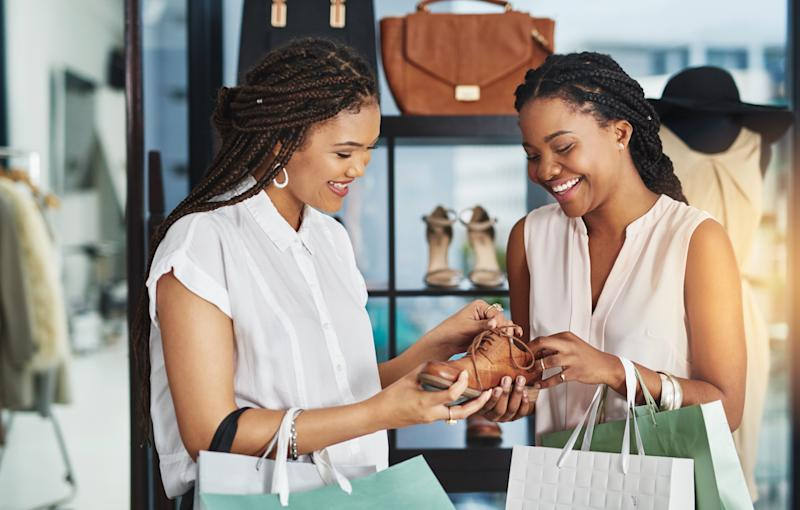 Black women are setting trends in many areas of consumerism, according to a recent report by Nielsen. (PeopleImages via Getty Images)