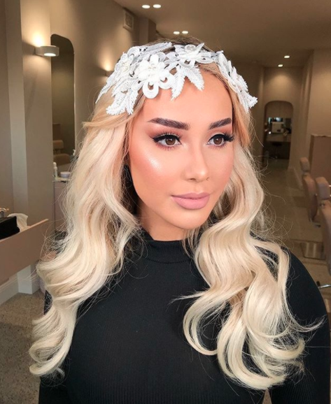 Fans barely recognised Cathy in this bridal makeover snap. Photo: Instagram/summertanx