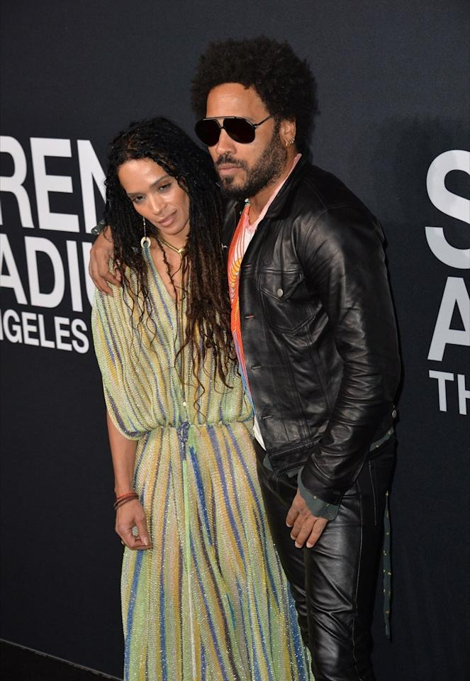 """Though they got divorced in 1993,<strong>Lisa Bonet</strong> and<strong>Lenny Kravitz</strong> have maintained a strong bond over the years in mutually raising their daughter, <strong>Zoë Kravitz</strong>. In fact, Lenny Kravitz even <a href=""""https://www.instagram.com/p/BrNZlIfggSc/?utm_source=ig_embed"""" target=""""_blank"""">shares matching rings</a> with Bonet's current husband, actor <strong>Jason Momoa</strong>, who gifted Kravitz the rings in 2018."""