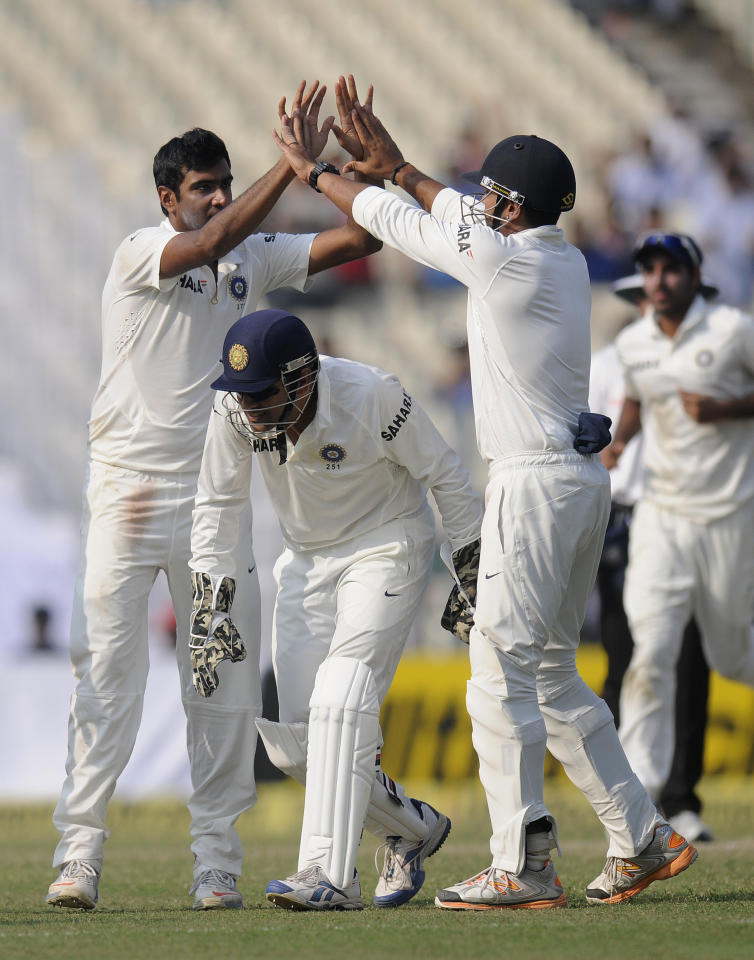 Ravichandran AShwin of India celebrates the wicket of Darren Bravo of West Indies during day three of the first Star Sports test match between India and The West Indies held at The Eden Gardens Stadium in Kolkata, India on the 8th November 2013  Photo by: Pal Pillai - BCCI - SPORTZPICS