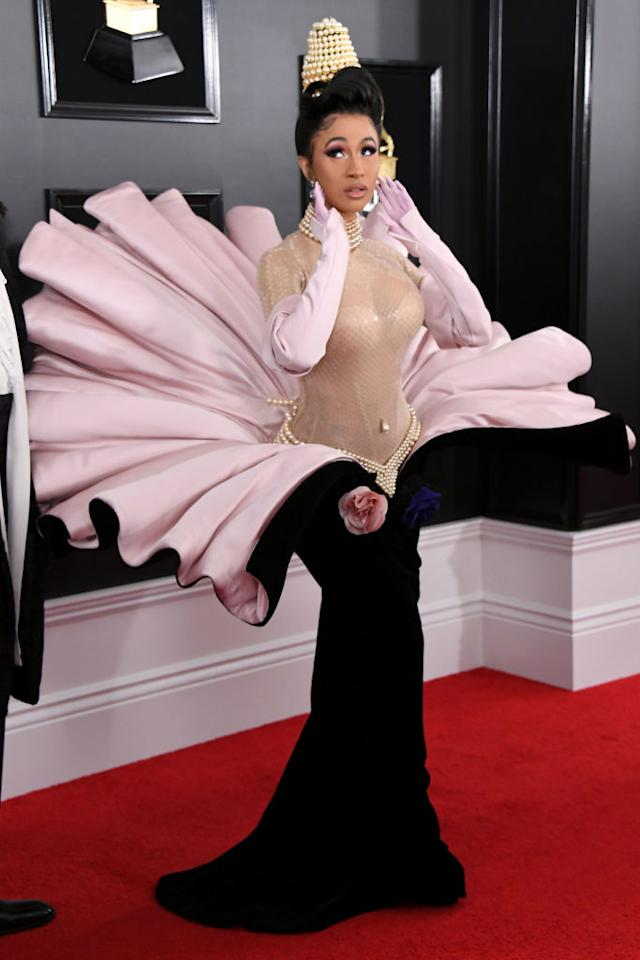 <p>Cardi B, one of the night's most nominated artists, stole the spotlight for multiple reasons. Besides the fact that her ex Offset accompanied her on the red carpet, she was wearing an elaborate ensemble that really got people talking. </p>
