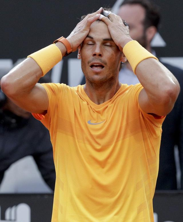 Spain's Rafael Nadal holds his head after beating Germany's Alexander Zverev in their final match at the Italian Open tennis tournament, in Rome, Sunday, May 20, 2018. Nadal won 6-1, 1-6, 6-3. (AP Photo/Gregorio Borgia)