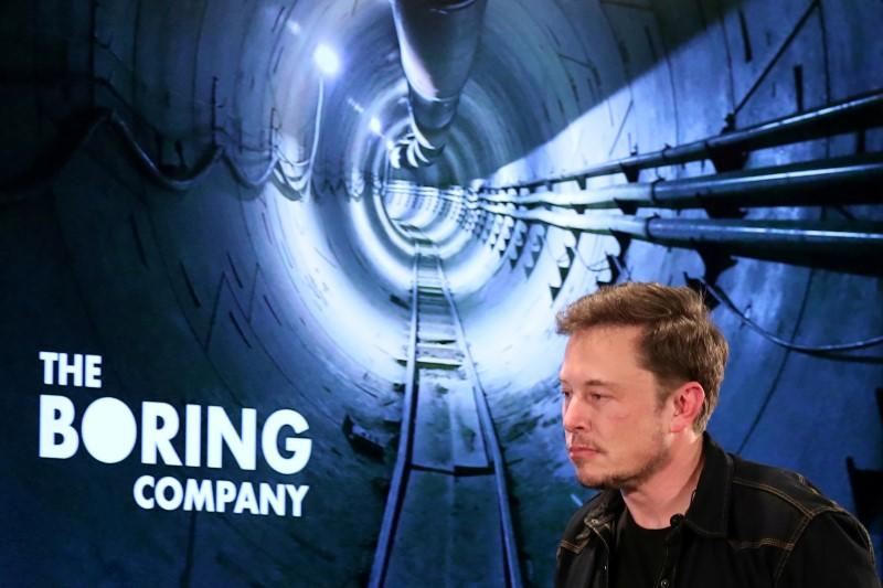 FILE PHOTO: Elon Musk arrives to speak at Boring Company community meeting in Bel Air, Los Angeles