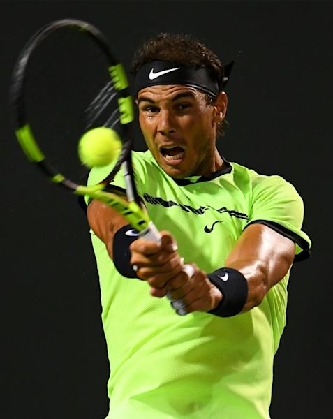 Rafael Nadal of Spain returns a shot during his Miami Open quarter-final match against Jack Sock of the US, at Crandon Park Tennis Center in Key Biscayne, Florida, on March 29, 2017