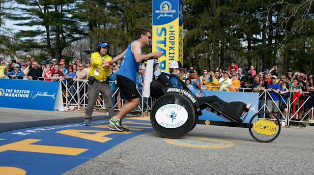 Former NHL player Bobby Carpenter and NWHL player Denna Laing teamed up to finish the Boston Marathon in 4:32:30 on Monday.