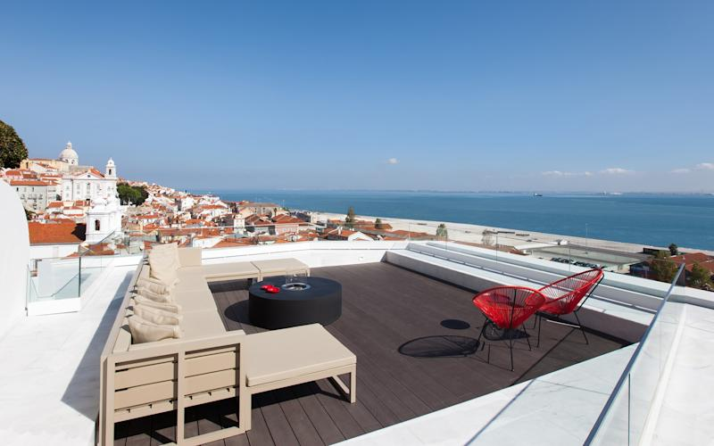 From its sleek terrace with inset pool, the Memmo Alfama possesses some of the best views of Lisbon's characteristic church spires and red rooftops