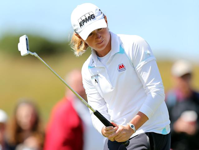 Stacy Lewis of the U.S putts on the 9th green during the Final day of the Women's British Open golf championship at the Royal Birkdale Golf Club, in Southport, England, Sunday, July 13, 2014. (AP Photo/Scott Heppell)