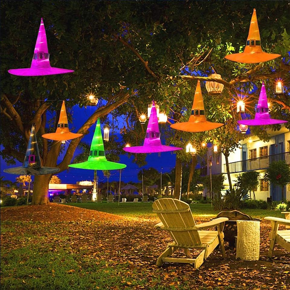 "<p>These <a href=""https://www.popsugar.com/buy/Maoyue-Outdoor-Hanging-Lighted-Glowing-Witch-Hats-486636?p_name=Maoyue%20Outdoor%20Hanging%20Lighted%20Glowing%20Witch%20Hats&retailer=amazon.com&pid=486636&price=41&evar1=savvy%3Auk&evar9=46570755&evar98=https%3A%2F%2Fwww.popsugar.com%2Fsmart-living%2Fphoto-gallery%2F46570755%2Fimage%2F46571010%2FMaoyue-Outdoor-Hanging-Lighted-Glowing-Witch-Hats&list1=shopping%2Camazon%2Challoween%2Challoween%20decor%2Coutdoor%20decorating&prop13=api&pdata=1"" rel=""nofollow"" data-shoppable-link=""1"" target=""_blank"" class=""ga-track"" data-ga-category=""Related"" data-ga-label=""https://www.amazon.com/MAOYUE-Halloween-Decorations-Operated-Lighting/dp/B07TGJWY8S/ref=asc_df_B07TGJWY8S/?tag=hyprod-20&amp;linkCode=df0&amp;hvadid=366288678718&amp;hvpos=1o1&amp;hvnetw=g&amp;hvrand=11367141027277046448&amp;hvpone=&amp;hvptwo=&amp;hvqmt=&amp;hvdev=c&amp;hvdvcmdl=&amp;hvlocint=&amp;hvlocphy=1014221&amp;hvtargid=pla-801483035210&amp;psc=1&amp;tag=&amp;ref=&amp;adgrpid=75985295013&amp;hvpone=&amp;hvptwo=&amp;hvadid=366288678718&amp;hvpos=1o1&amp;hvnetw=g&amp;hvrand=11367141027277046448&amp;hvqmt=&amp;hvdev=c&amp;hvdvcmdl=&amp;hvlocint=&amp;hvlocphy=1014221&amp;hvtargid=pla-801483035210"" data-ga-action=""In-Line Links"">Maoyue Outdoor Hanging Lighted Glowing Witch Hats</a> ($41, set of eight) are so cool.</p>"