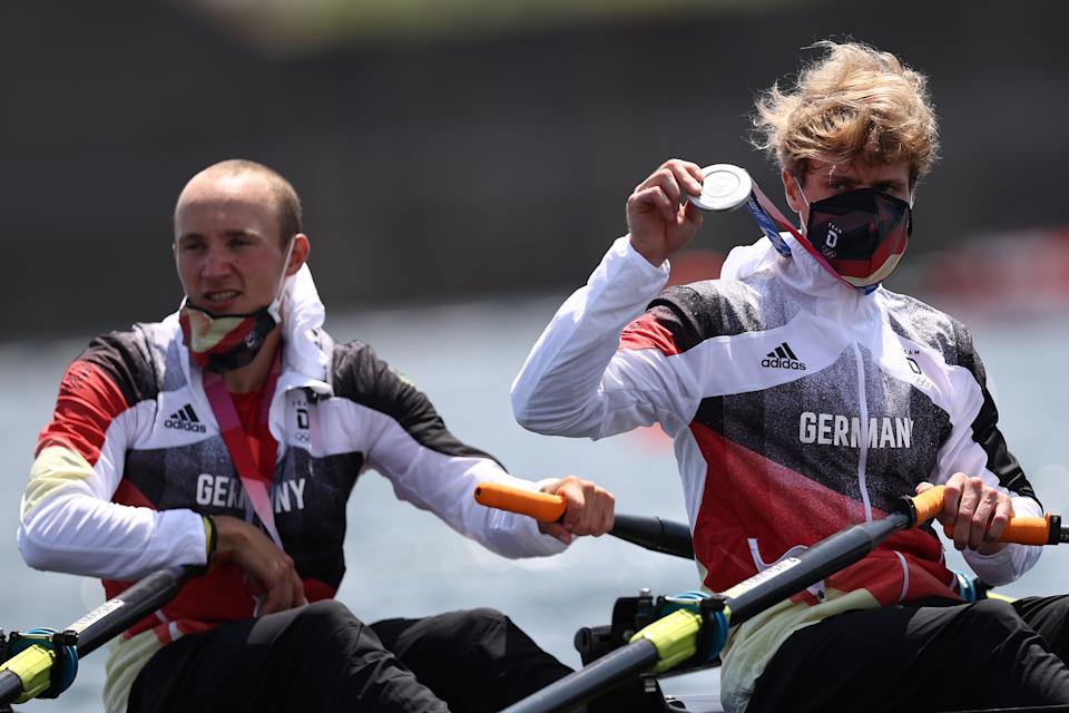 TOKYO, JAPAN - JULY 29:  Silver medalists Jonathan Rommelmann and Jason Osborne (R) of Team Germany pose with their medals on their boat after the Lightweight Men's Double Sculls Final A on day six of the Tokyo 2020 Olympic Games at Sea Forest Waterway on July 29, 2021 in Tokyo, Japan. (Photo by Maja Hitij/Getty Images)