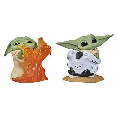 """<p><strong>Star Wars</strong></p><p>amazon.com</p><p><strong>$11.79</strong></p><p><a href=""""https://www.amazon.com/dp/B088GNTQMR?tag=syn-yahoo-20&ascsubtag=%5Bartid%7C10055.g.29624061%5Bsrc%7Cyahoo-us"""" rel=""""nofollow noopener"""" target=""""_blank"""" data-ylk=""""slk:Shop Now"""" class=""""link rapid-noclick-resp"""">Shop Now</a></p><p>Need just a little something? Give your <em>Star Wars</em> fanatic a pack of Baby Yoda collectibles (each pack comes with two figurines) depicting the season's favorite scenes. <em>Ages 4+</em></p>"""